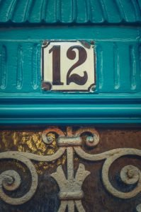 Apartment number 12 on rustic blue door