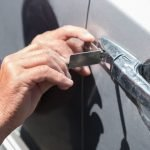 Car locksmith specialist unlocking door