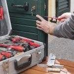 Professional locksmith repair a door lock