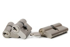 Residential locksmith three lock cylinders with a key