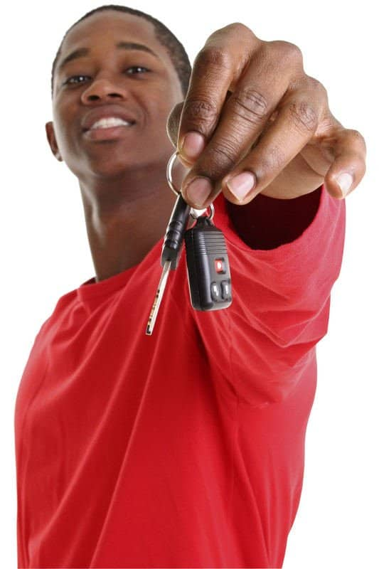 Young man holding car keys from Mobile Locksmith